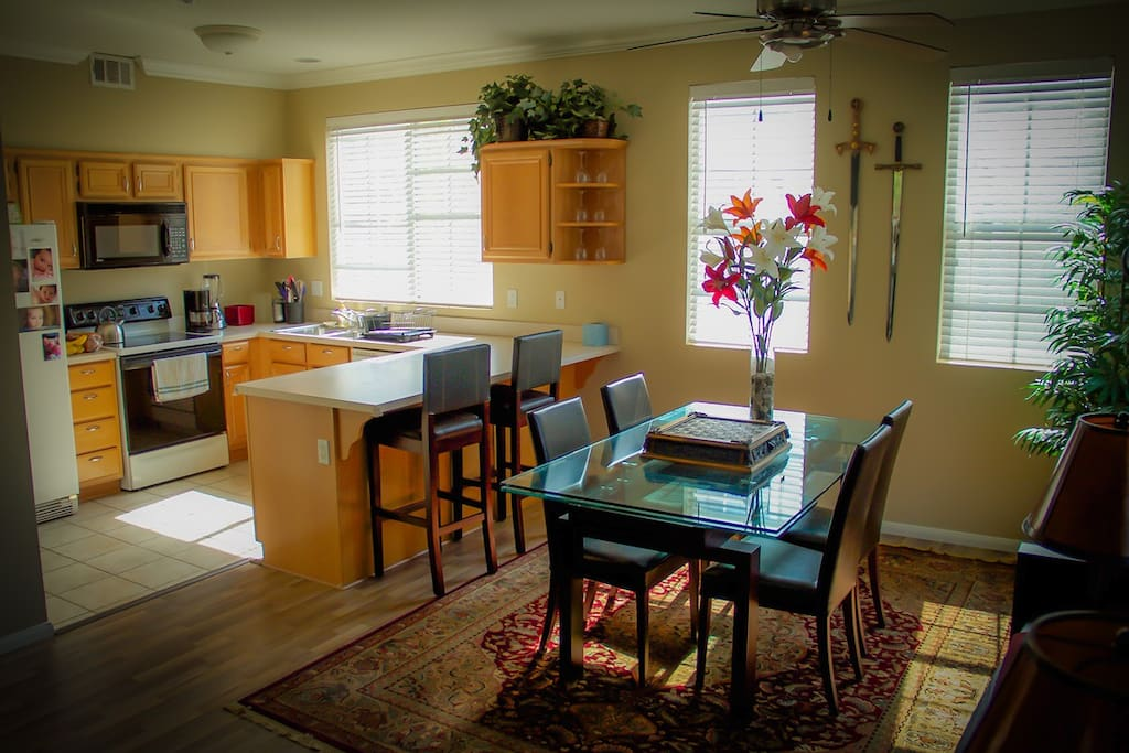 Features a complete kitchen, refrigerator, microwave, toaster, and coffee maker.