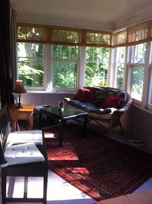 The front enclosed sun porch, as you enter my home, is a peaceful retreat for reading and relaxing. Open access to it as a guest in my home.
