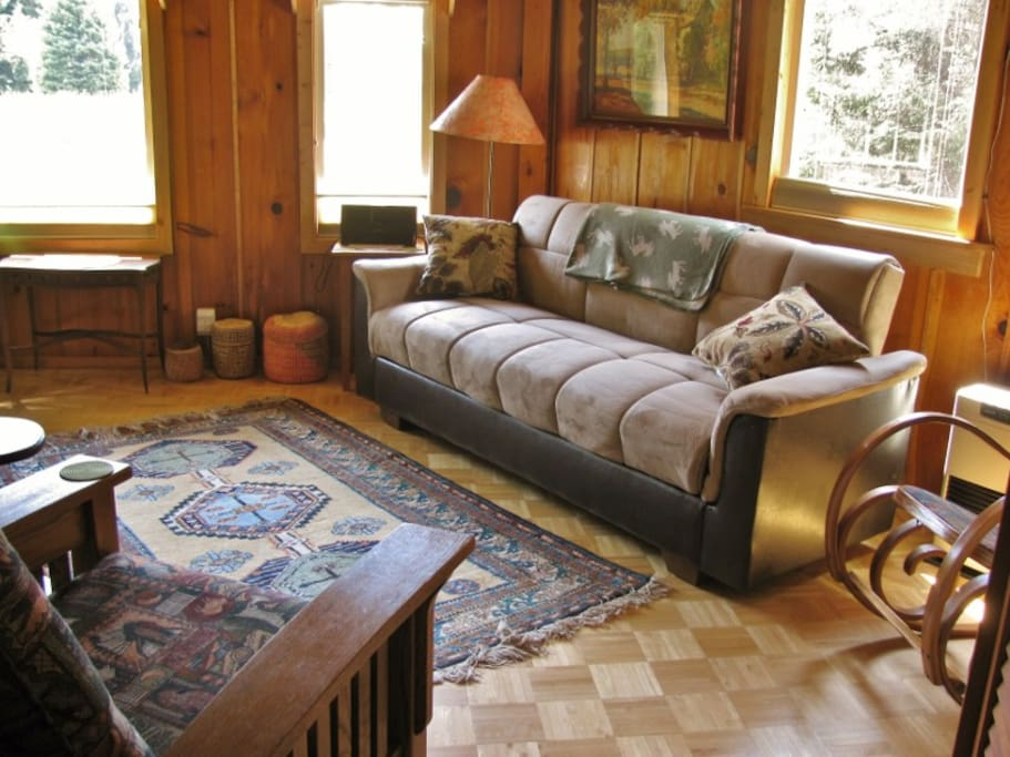 Black bear and moose have been spotted from this cozy main room!