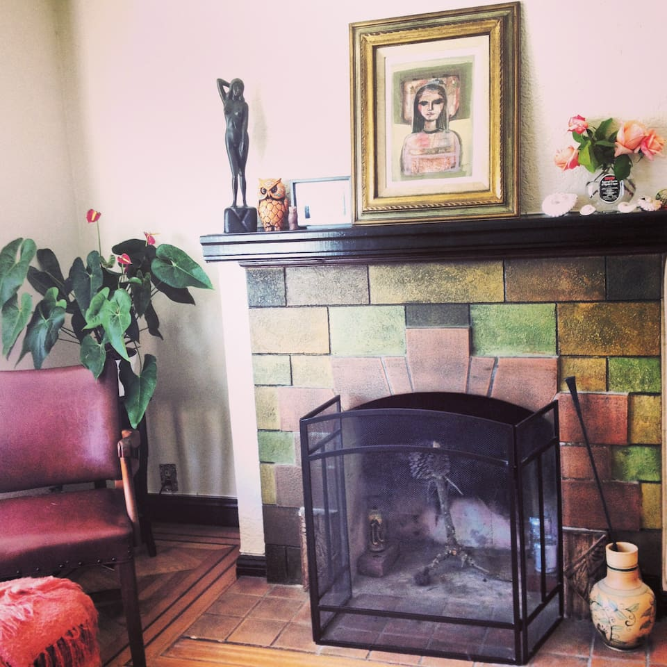 A working fireplace with original tile from the 1920s with parquet hardwood floor goodness!