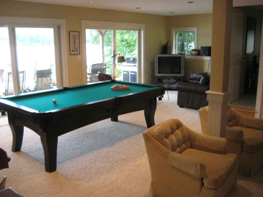Game room includes full-size pullout couch and bathroom with a shower.