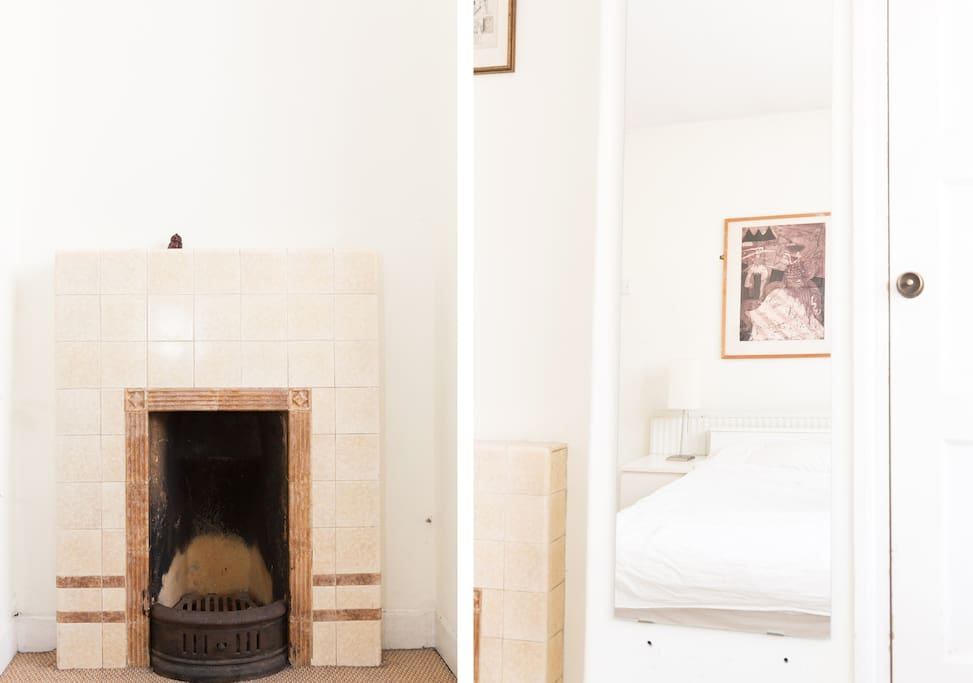 Features include original fireplace and built in wardrobes.
