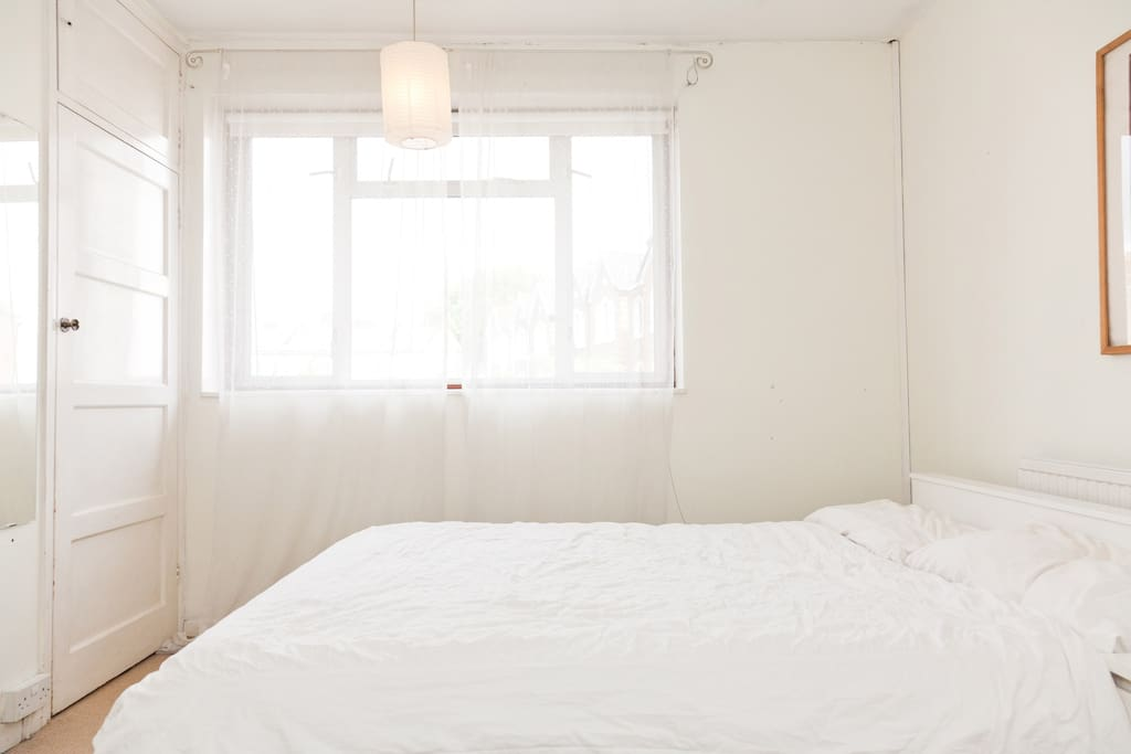 Spacious clean bedroom with double bed