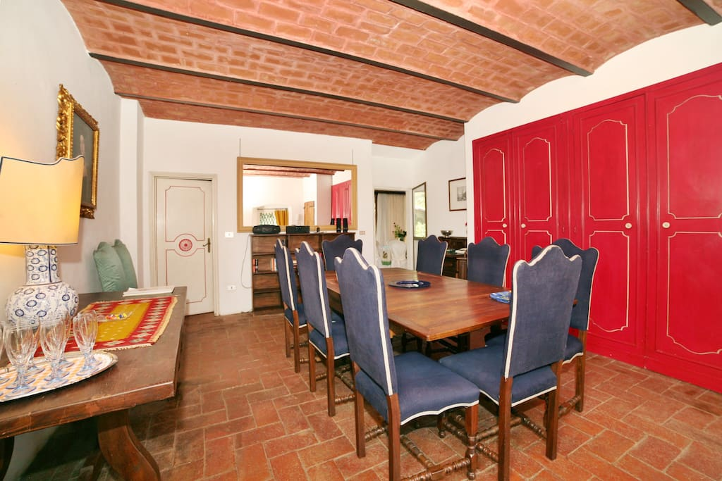 The Dining Room with vaulted ceiling and elegant high blue velvet chairs.