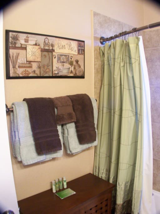 Guest bathroom features a credenza full of complementary toiletries if needed.