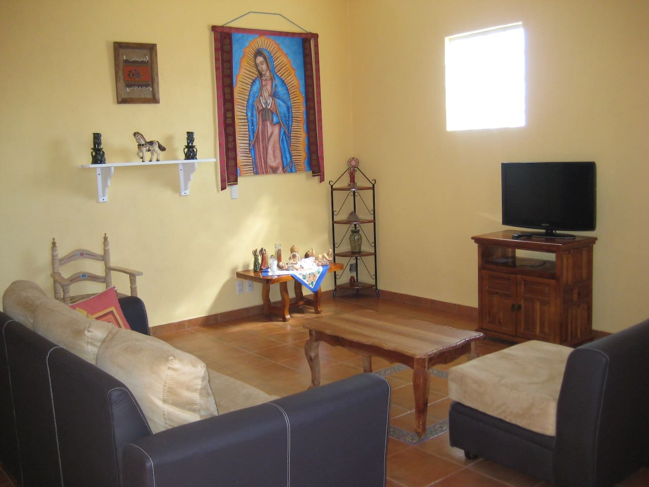 The living room with original painting of Guadalupe/Tonantzin