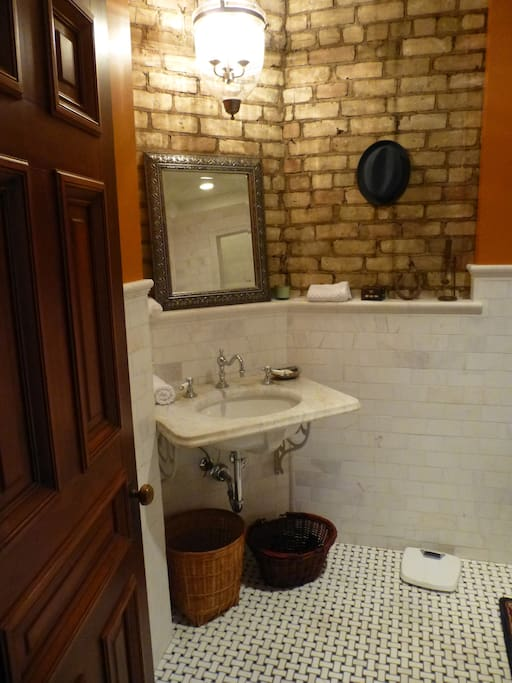 Comfortable private bath with period details.  Heated tile floor.