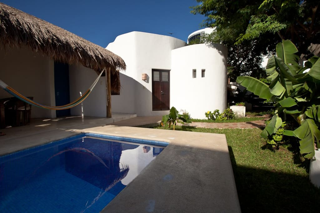 The Sugar Bungalow and its terrace by the pool