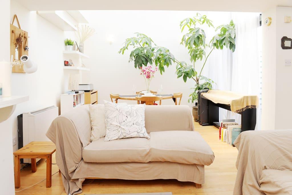 Living Area, with Piano and Dining Area for Four