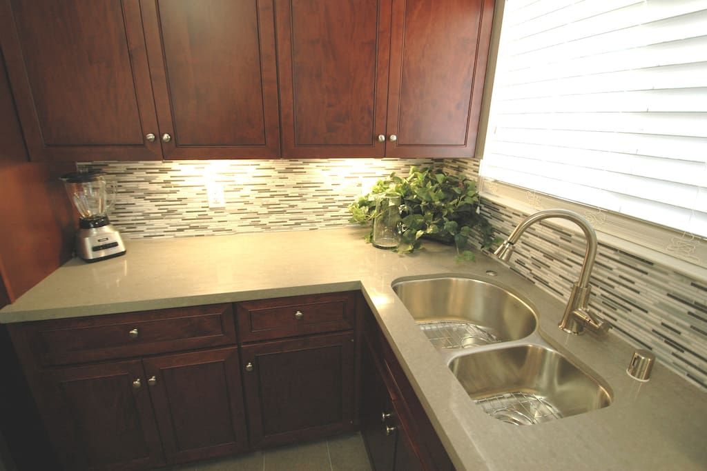 Fully equipped kitchen with double sink.