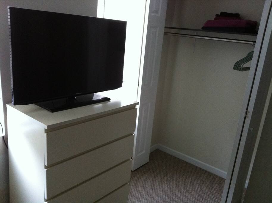 Dresser, TV and Closet.  There are two windows in the room too!
