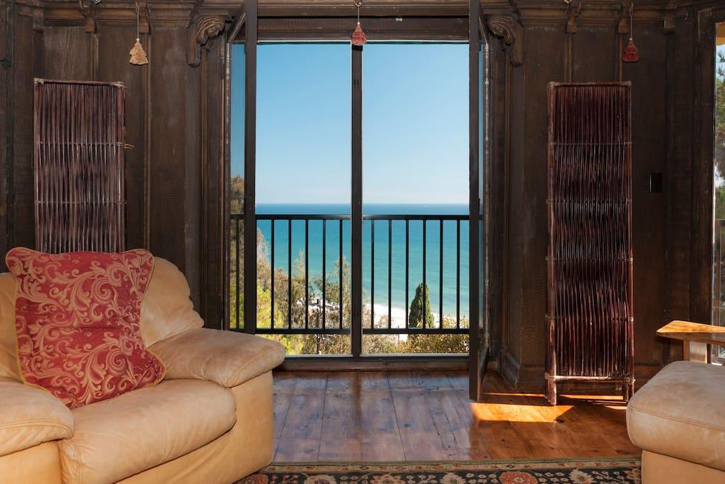 Oversized glass windows open to let in the ocean breeze.