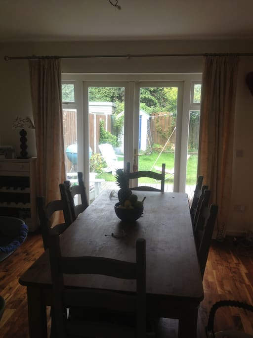 Kitchen / dining room backing out facing the back garden. Table seats 6 people comfortably
