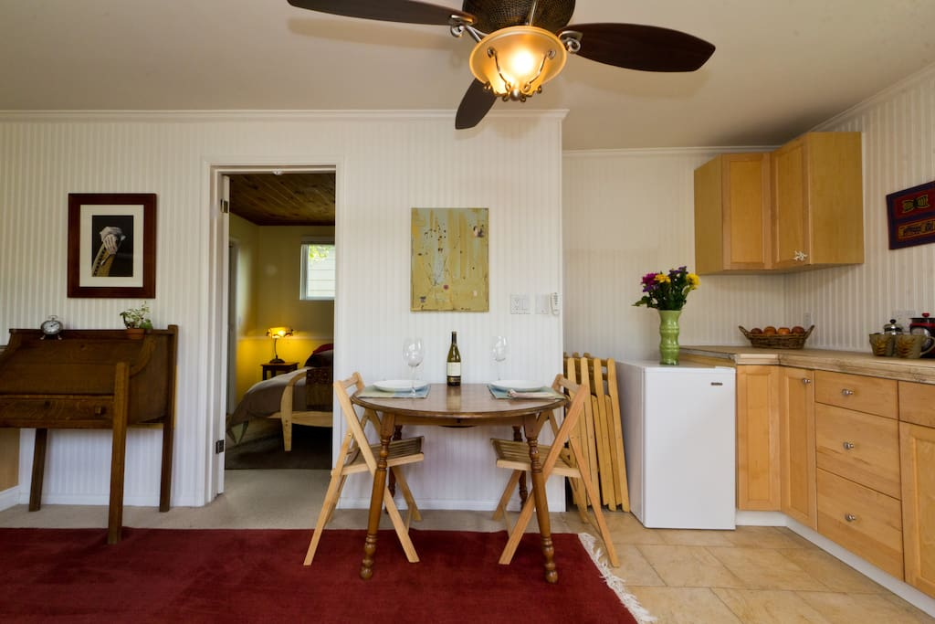 Enjoy coffee or a home-cooked meal at the kitchen table which easily grows to accommodate four.