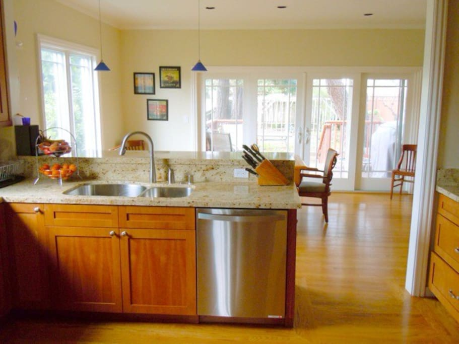 Kitchen opens onto spacious eating/sitting area, outdoor deck and large back yard
