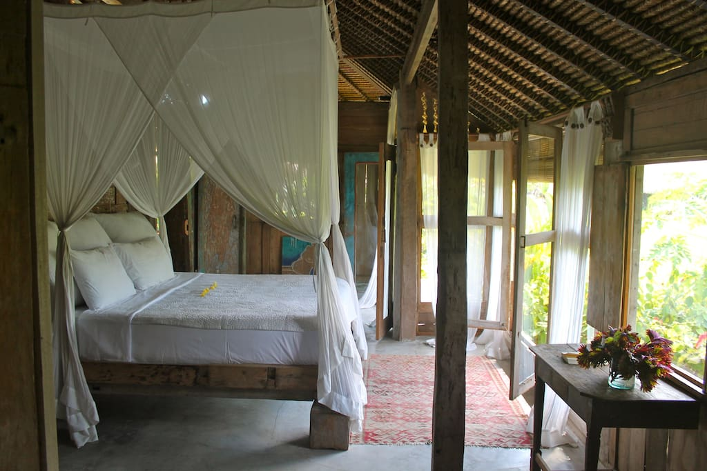 View of spacious bedroom with comfy king size bed overlooking the rice paddies.