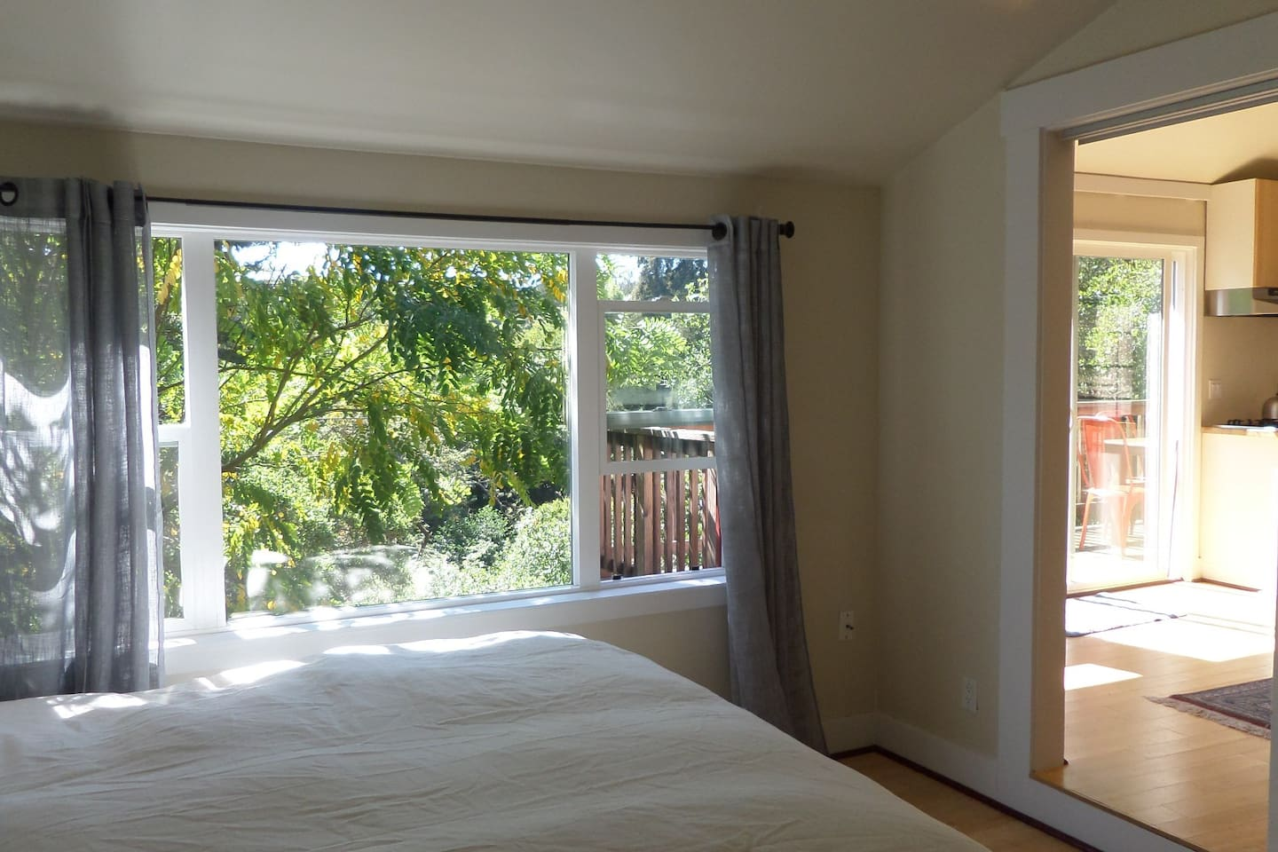 new bed: king sized, facing the serene view of trees  and sunshine....