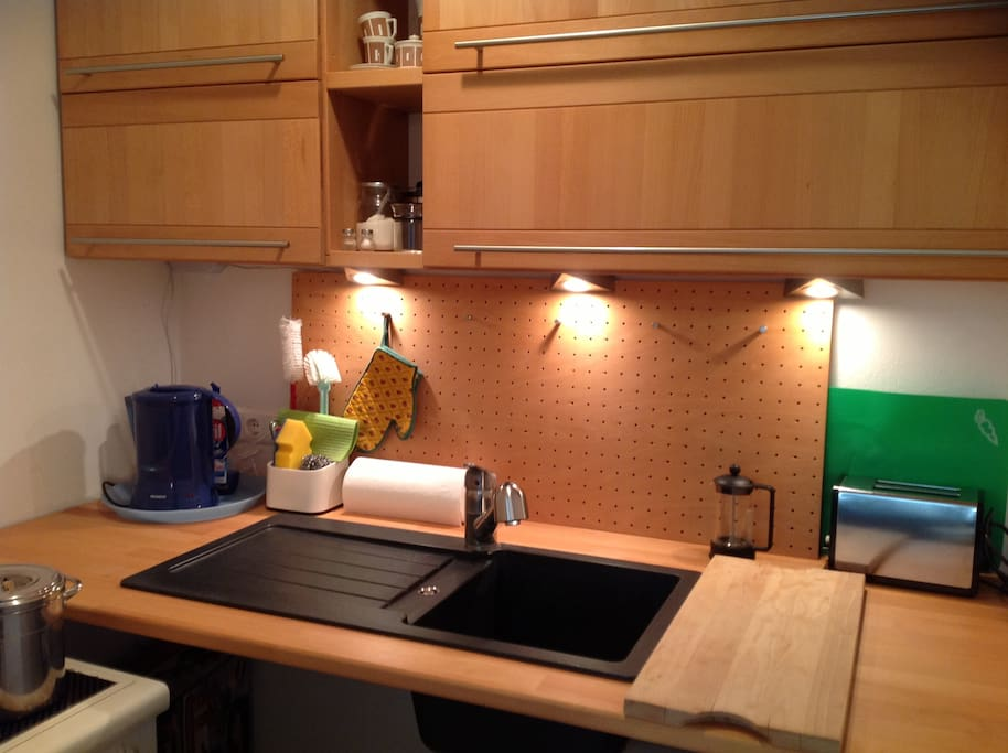 kitchenette with cupboards, sink, water-kettle and coffeemachine ( not on this pix), in the left corner you can see the stove