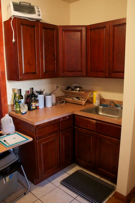 This is a photo of our kitchen sink, cabinets and counter.