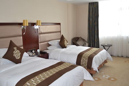 青海省西宁市城东经济开发区昆仑东路56号福茵长乐国际大酒店 - Xining - Bed & Breakfast