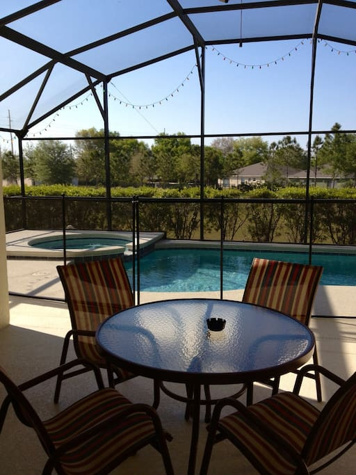 Relaxing private pool deck area with table for 4 and 2 sun loungers