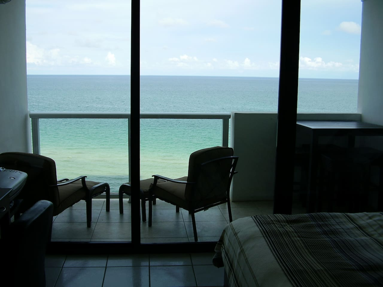 Recently renovated balcony with new furniture including a patio height table to enjoy the ocean while dining