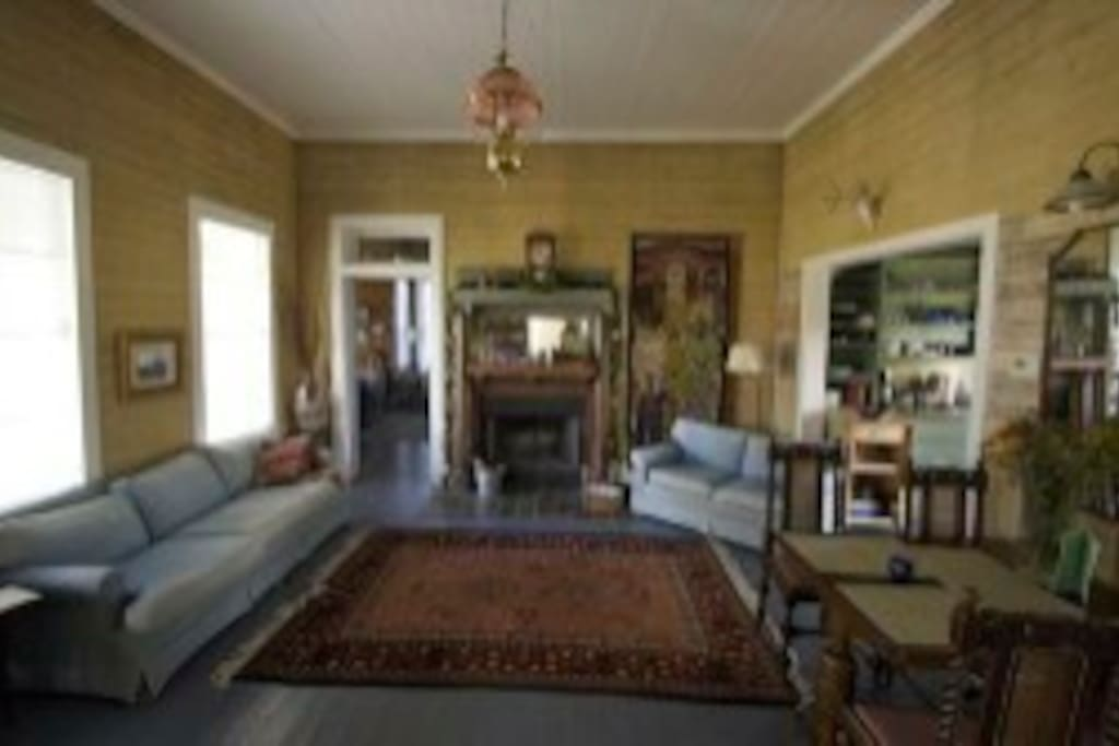 Maetze House features large breezy front porch with rocking chairs, 3 bdrm/3 bath home.