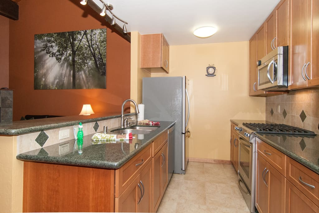 Newly remodeled kitchen is well stocked and equipped for large gatherings