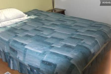Cheap, affordable, private and comfortable accommodation. Safe environment. Friendly host. Wi-fi, cable TV  available in shared area.. Free parking space on driveway and street. Laundry facilities on-site available to guests.