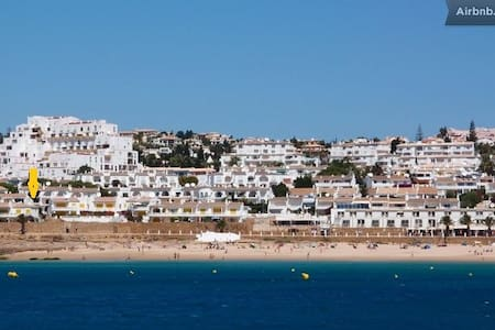 "The little fisher village PRAIA DA LUZ became a synonym for relaxing holidays within a stunning landscape. From the Roman Bath Apartment on the dead-end  ""Street of the Roman Bath"" you walk 5 minutes to the Beach. You hear the waves during breakfast!"