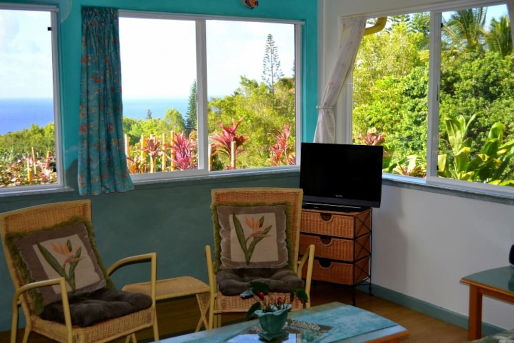 living room with oceanview at Whispering Bamboo Cottage