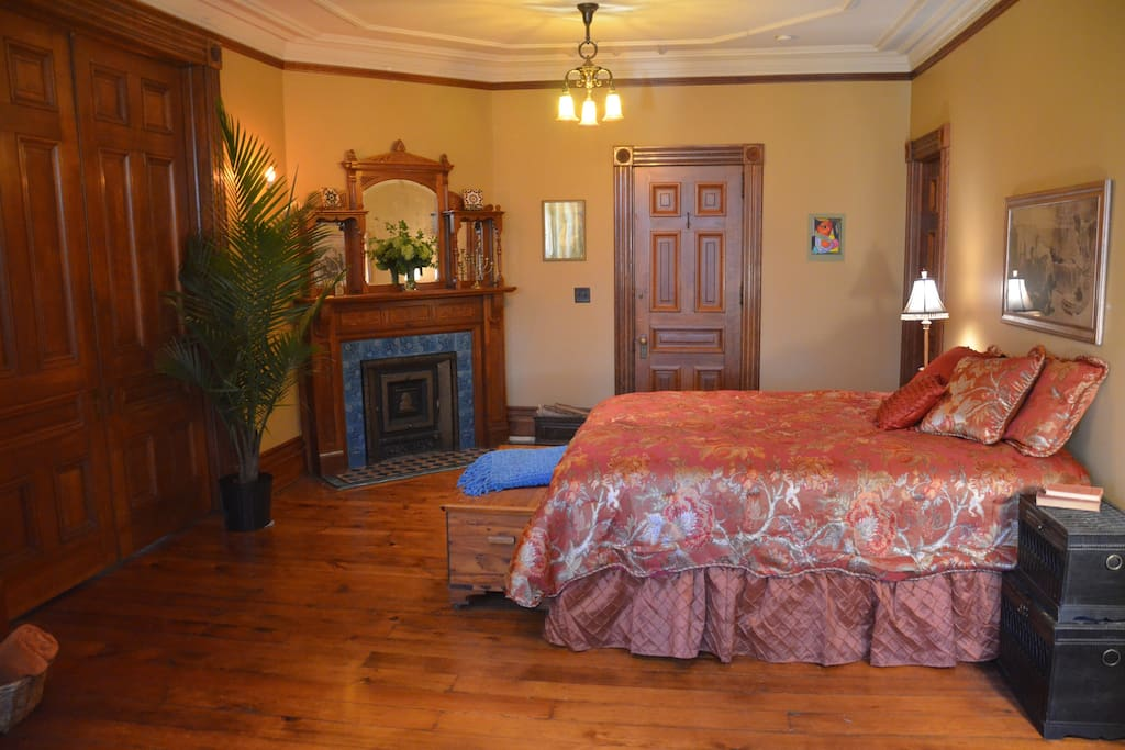 Large master bedroom includes working fireplace with beautiful tile and woodwork.