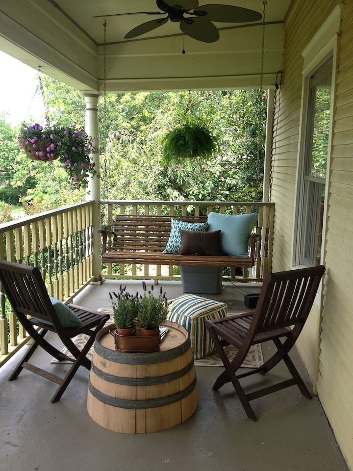 The sitting area on the front porch. A fine spot to watch the world go by.