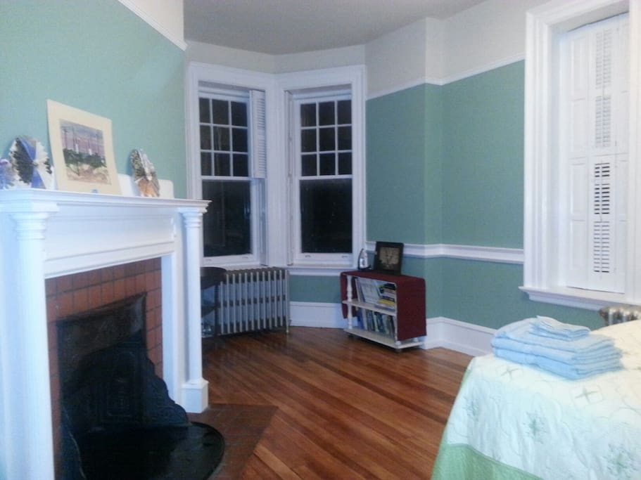 bay window and fireplace in bedroom