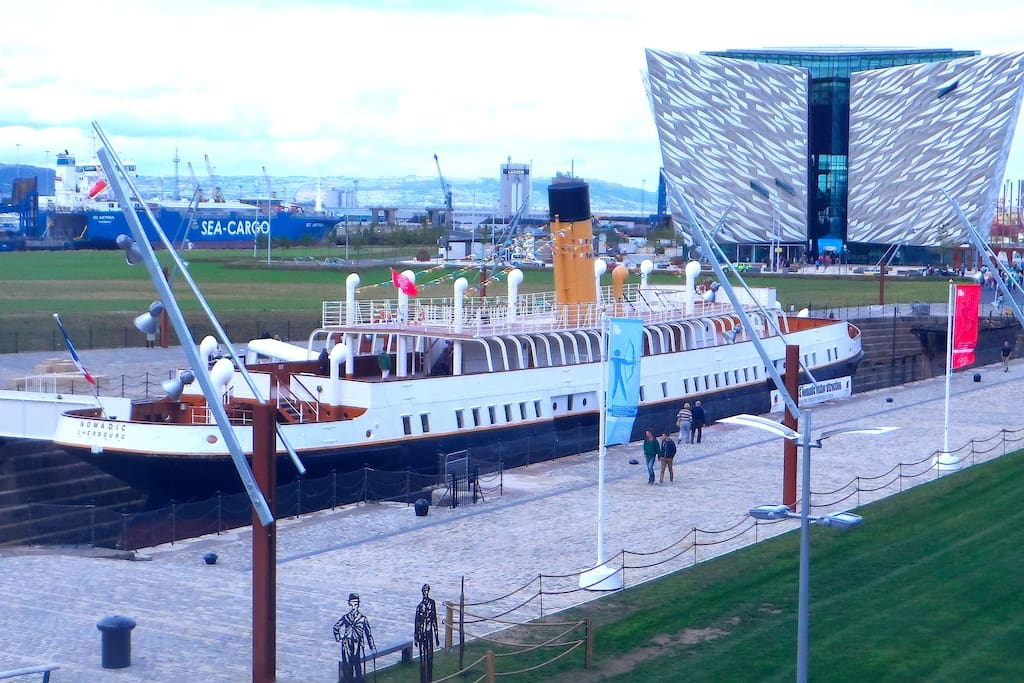 Titanic Belfast Visitor Centre and SS Nomadic boat - took passengers onto the Titanic Ship 100 years ago...seen from apartment