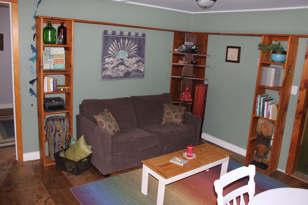 Sitting room in the karma cabin. Sofa bed converts to a double bed.