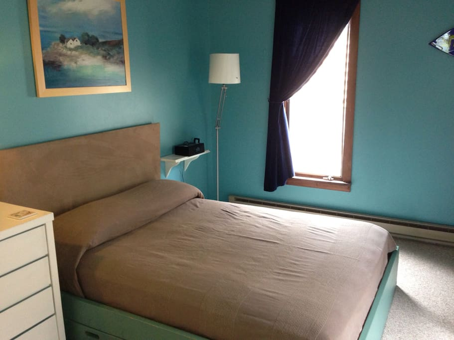 Main level bedroom with a double bed.