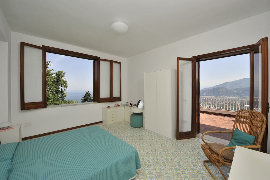 First floor double bedroom with private bathroom, window + large balcony
