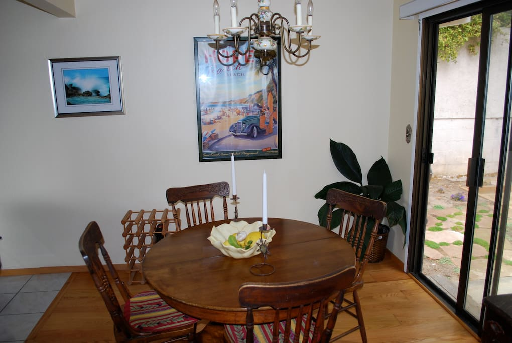 The dining room area that includes an antique oak table and chairs.