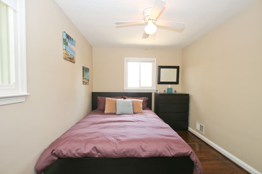 Bedroom with Queen size bed and 4 drawer dresser