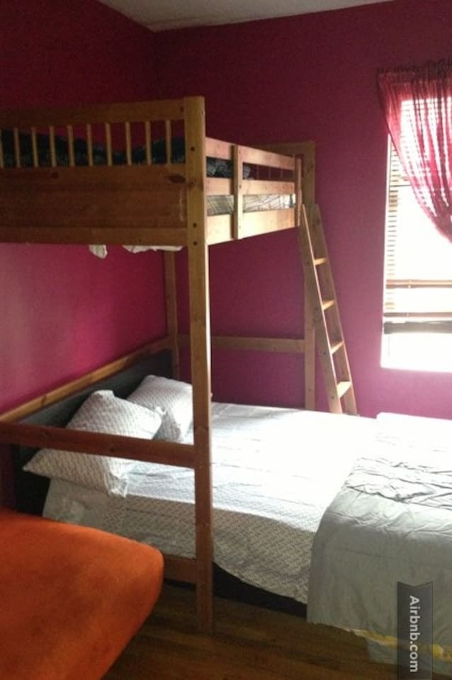 The bedroom, with one full-sized bed and one twin-sized bed