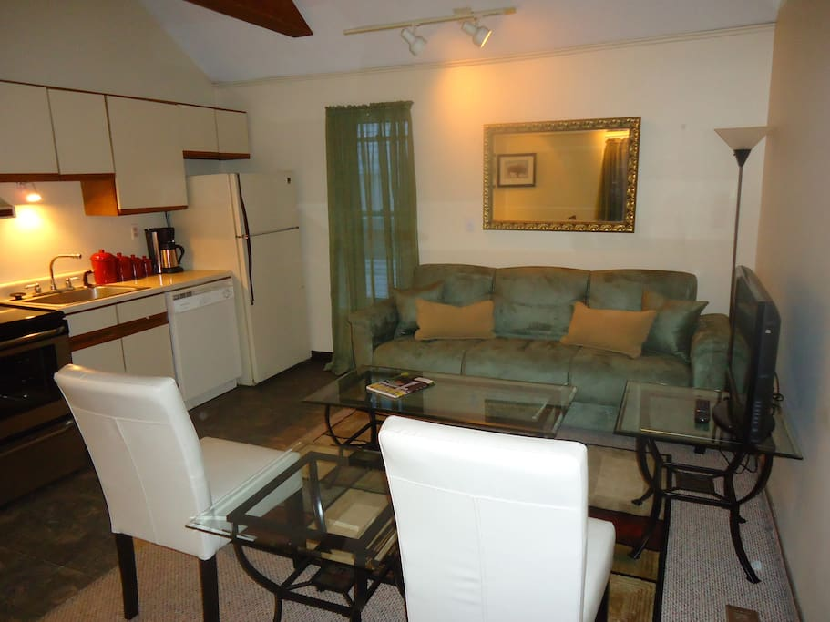 Cozy living room area equipped with TV, cable and a sofa-bed to accommodate a third guest