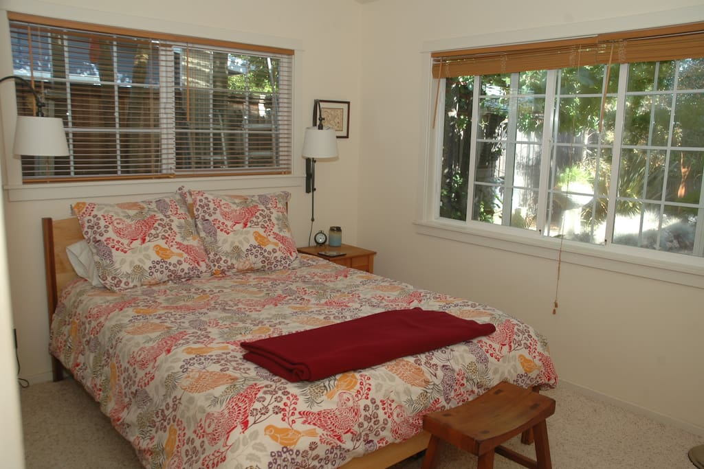 Guestroom with peaceful views into a quiet garden and a morning greeted by feeding finches