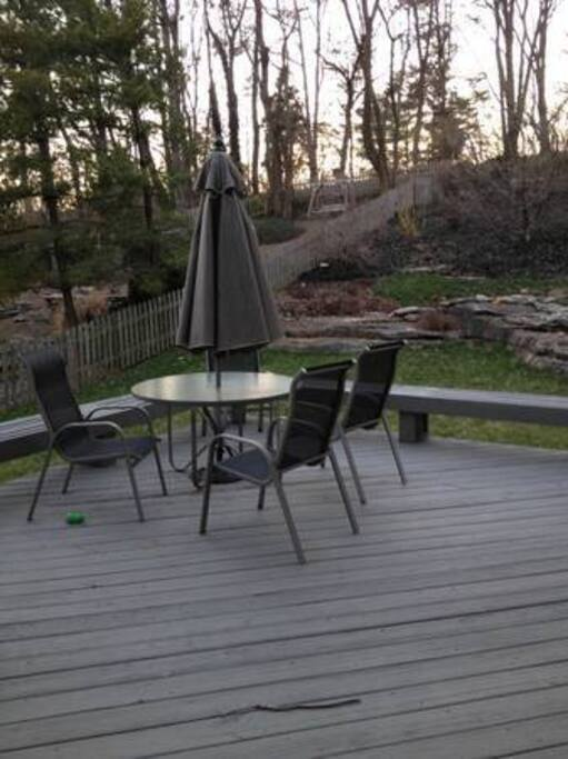 Private backyard with Ducane grill and table.