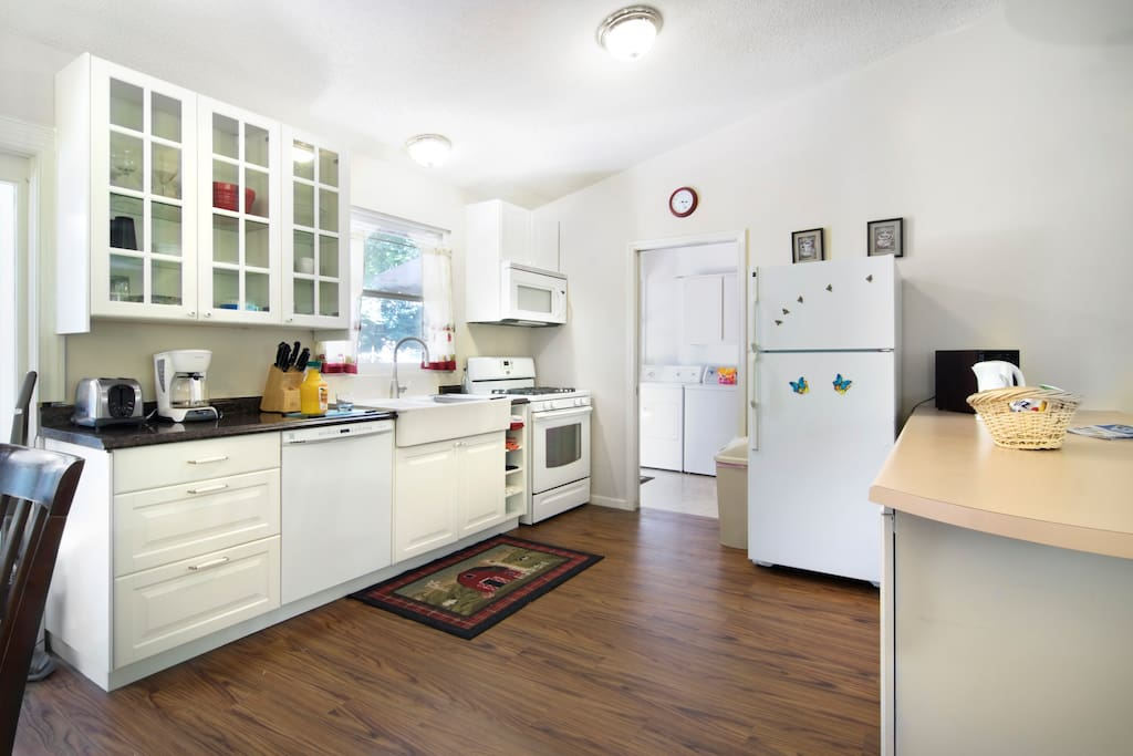 Spacious kitchen with lots of amenities.  Laundry just beyond.