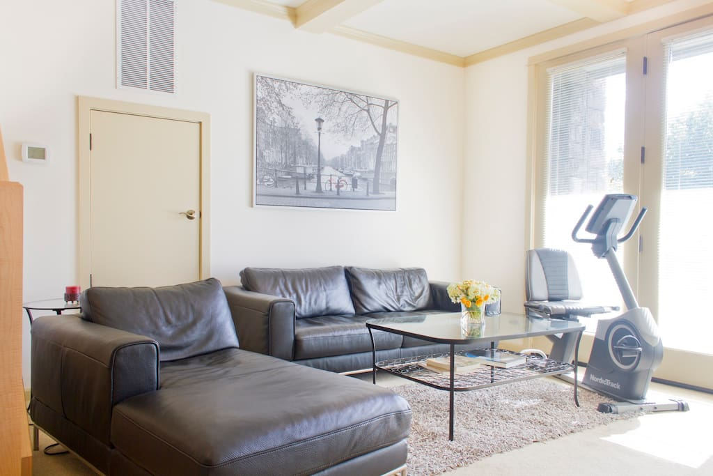 """The family room is yours to enjoy.  Includes a 52"""" TV with all premium cable channels and a DVD player, an exercise bicycle and plenty of room to relax."""