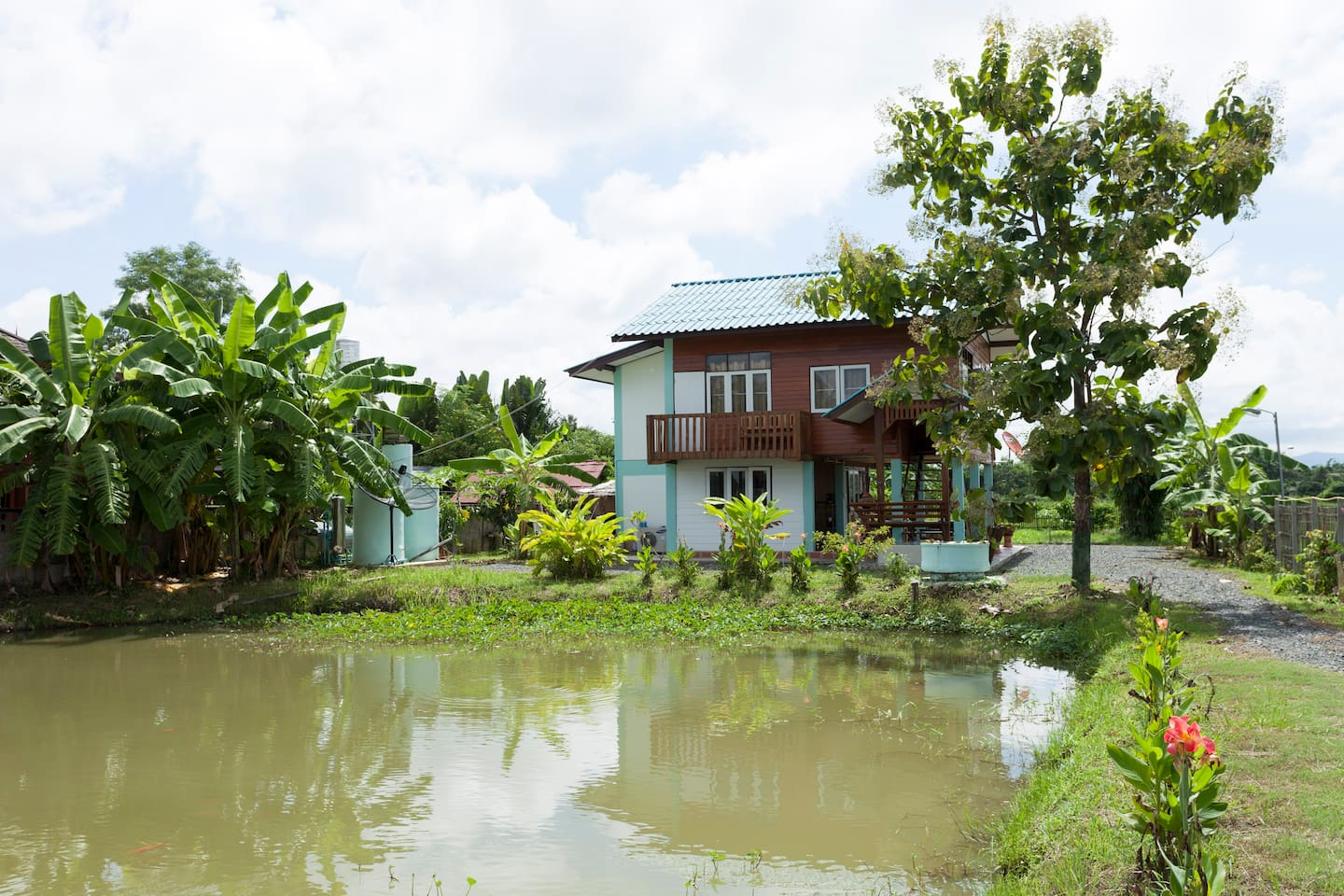 Teakhouse seen over ths fish pond