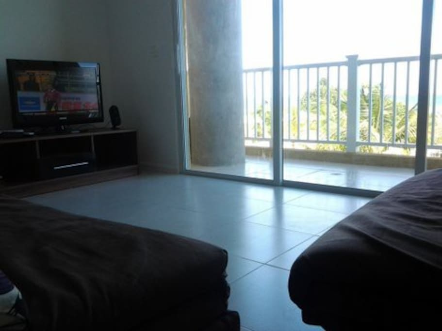 The living room with plasma TV  and channels