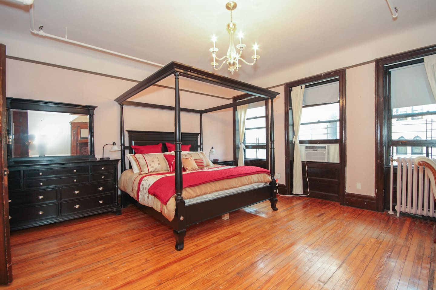 Huge room with four-poster bed, new linens, and plenty of storage for your things!
