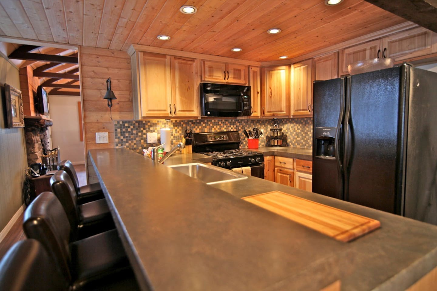 Remodeled kitchen with polished concrete counter tops